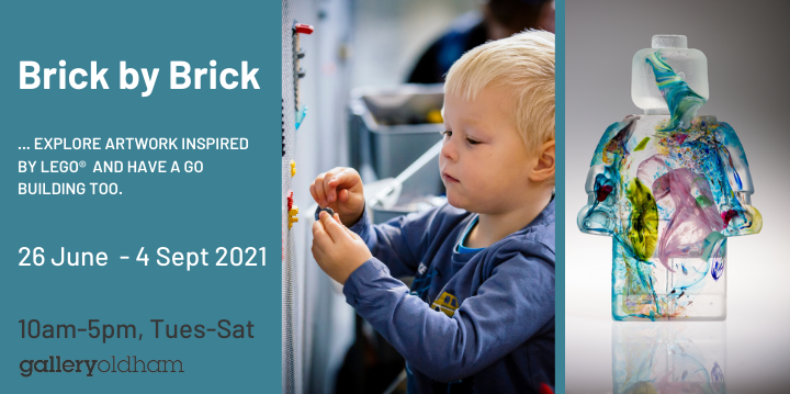 Boy playing with lego and huge lego figure advertising the Brick by Brick exhibition from 26 June to 4 Sept